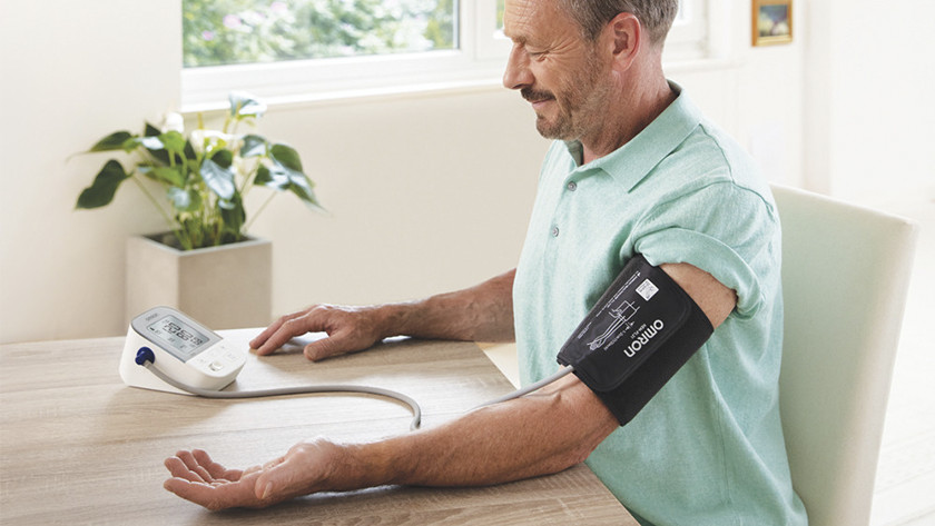 Blood pressure monitor around the upper arm