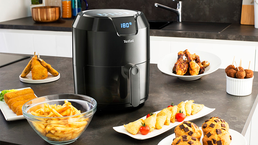 Airfryer with fries, chicken, croquettes, and apple tarts