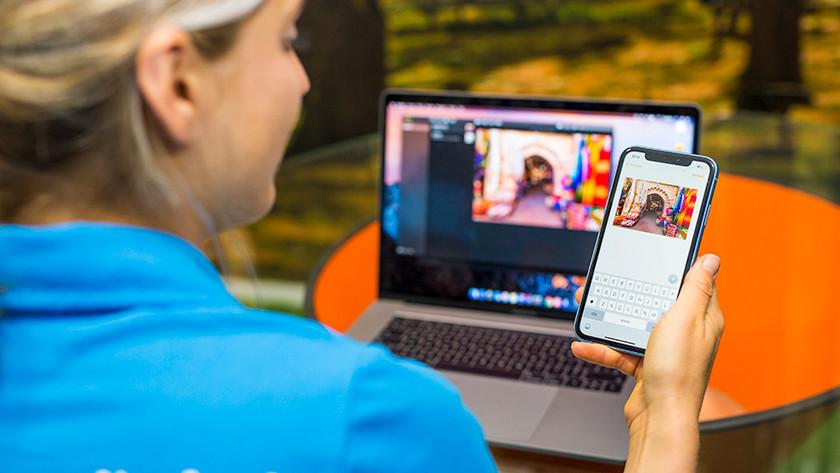 Apple iPhone en Apple MacBook in gebruik