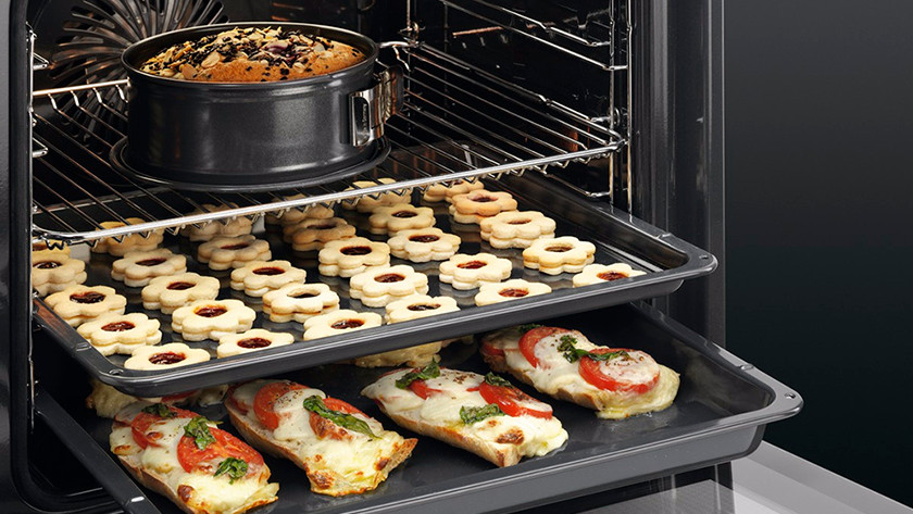 Oven with cake, cookies, and paninis