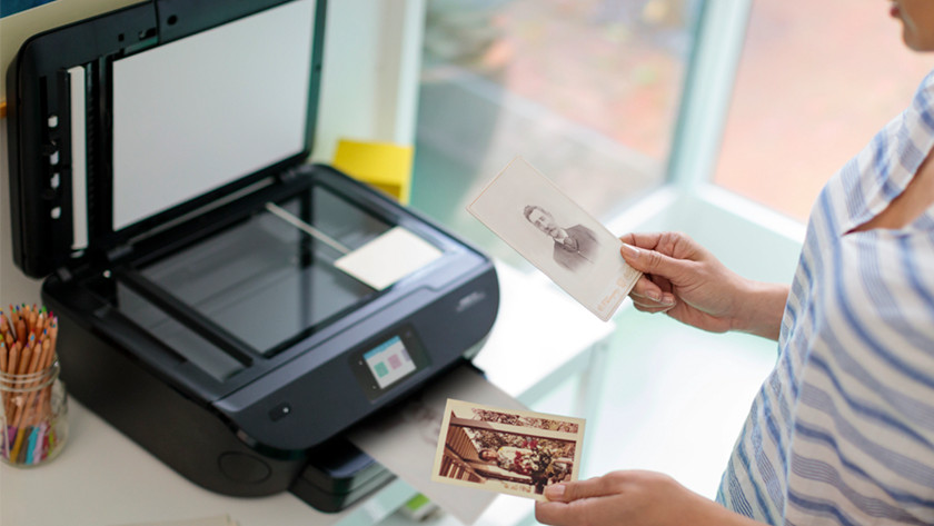 Man scans photos with all-in-one printer