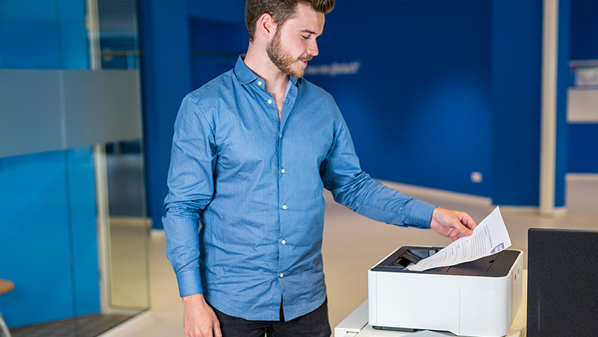 Man prints with commercial printer