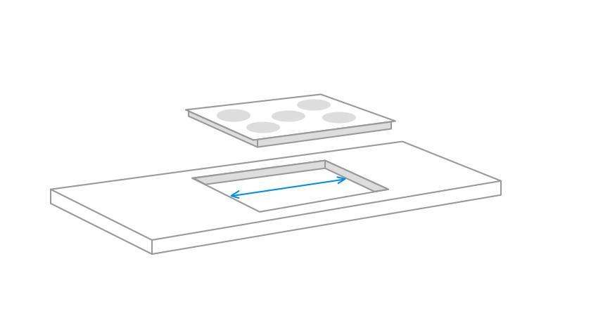 mesurer la largeur de la niche d'encastrement pour la plaque de cuisson
