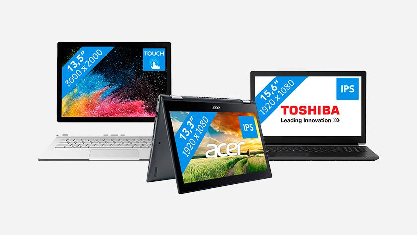 Een Microsoft Surface, Acer en Toshiba laptop.