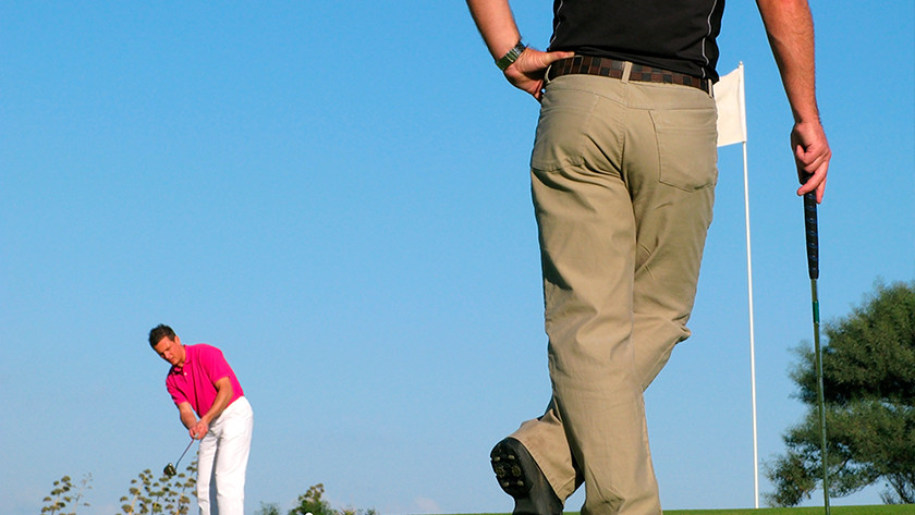 Golfers met sporthorloge