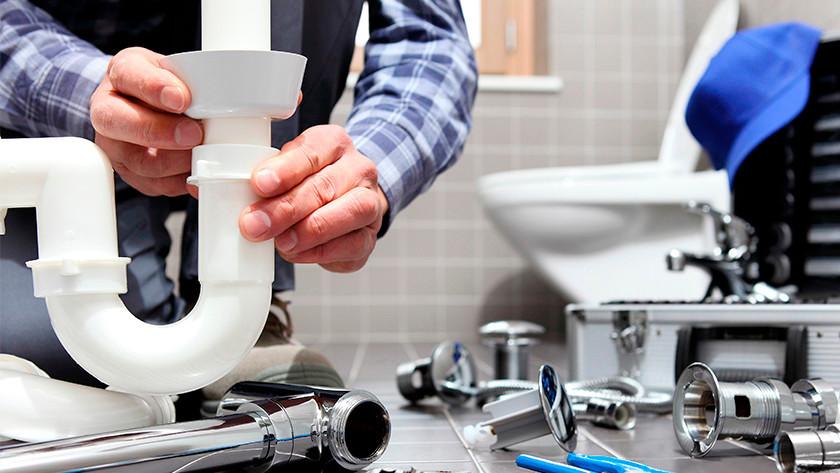 Wasmachine afvoer ontstoppen