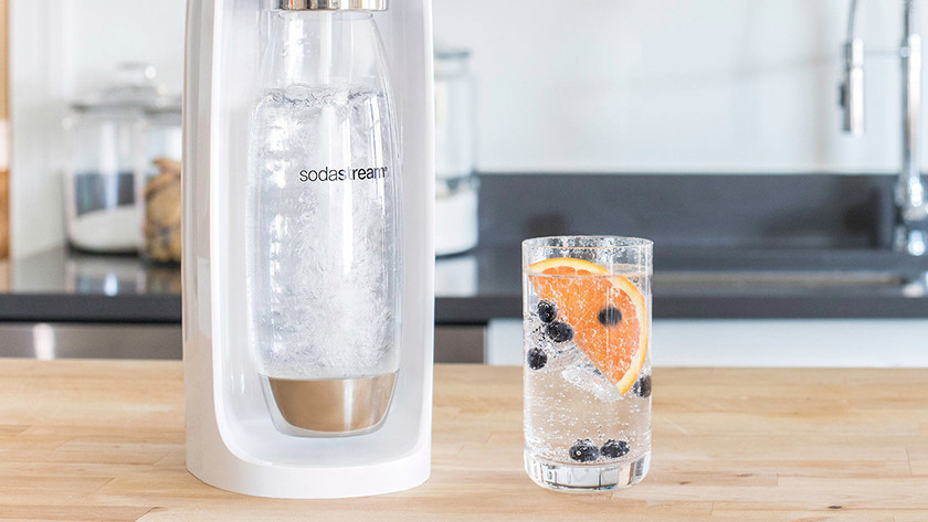 White SodaStream  with glass with sparkling water