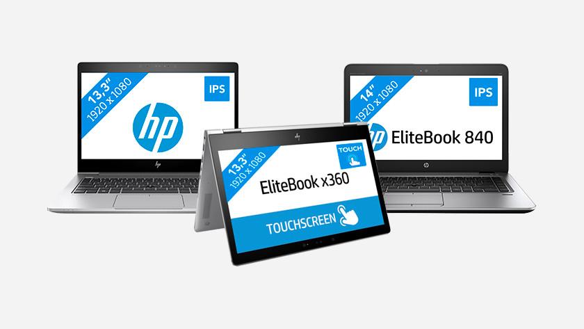 Drie HP EliteBook laptops.