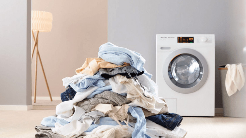 Washing machine with pile of laundry