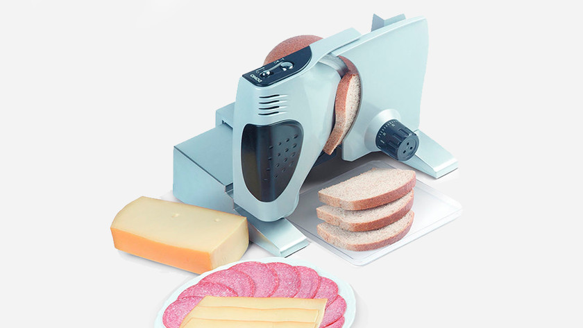Slicer with slices of bread and cheese