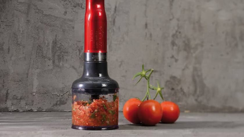 Immersion blender with tomato tapenade in food chopper