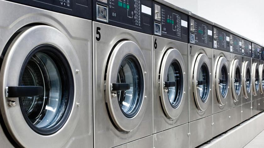 Machines à laver avec système de pièces