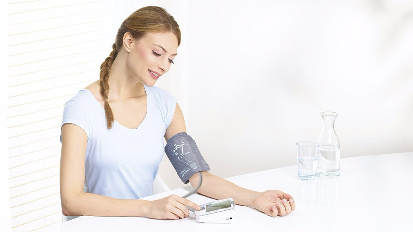Woman with blood pressure monitor