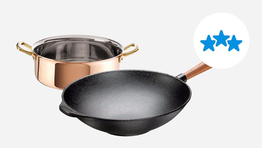 koperen kookpan en gietijzeren wokpan