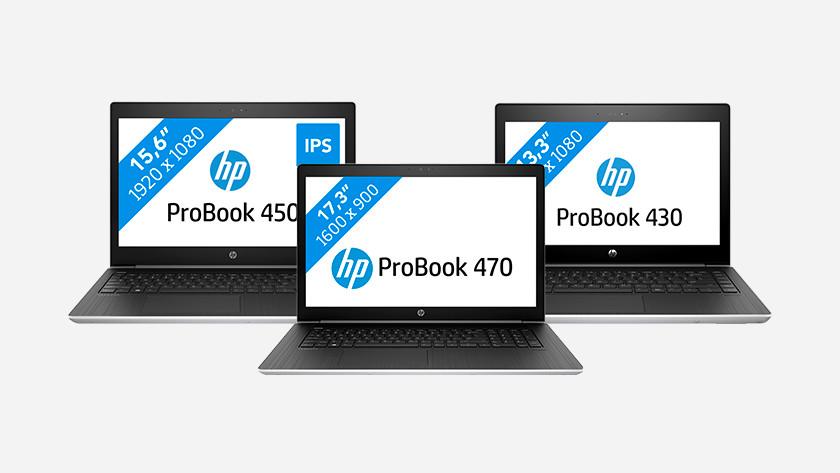 Drie HP ProBook laptops.