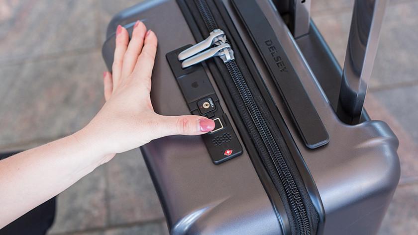 Open suitcase with fingerprint