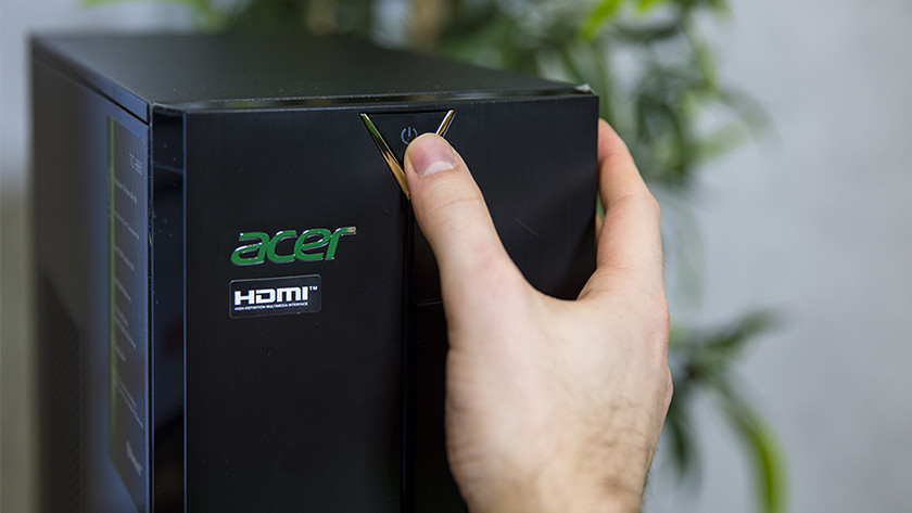 Hand switches on Acer desktop PC.
