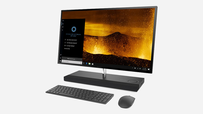 All-in-one PC viewed from the side with keyboard and mouse.