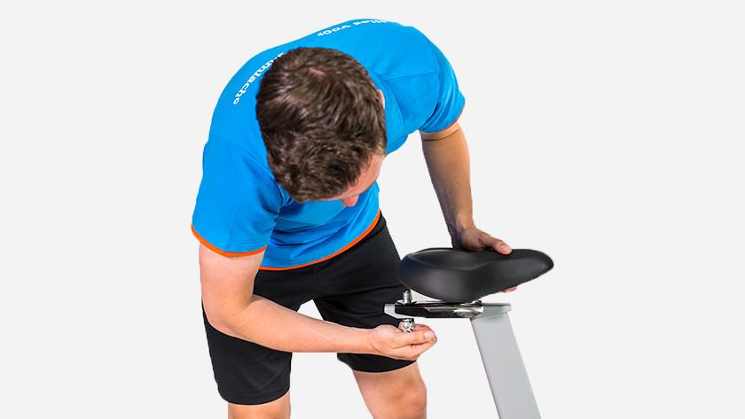 Exercise bike adjustable saddle