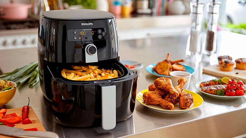 airfryer with fries, chicken, and vegetables
