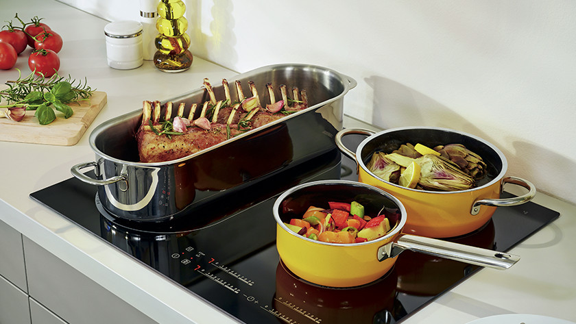 Induction cooktop with pans