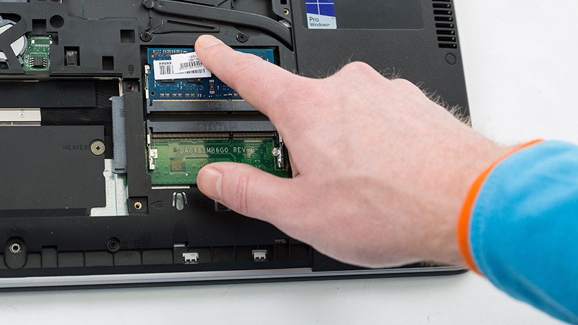 Insert new RAM memory module in laptop