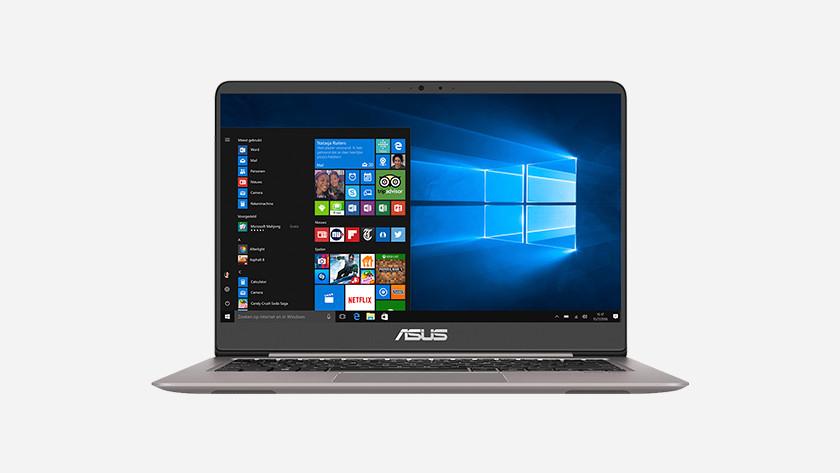 Asus laptop met Windows 10 startmenu op beeldscherm.