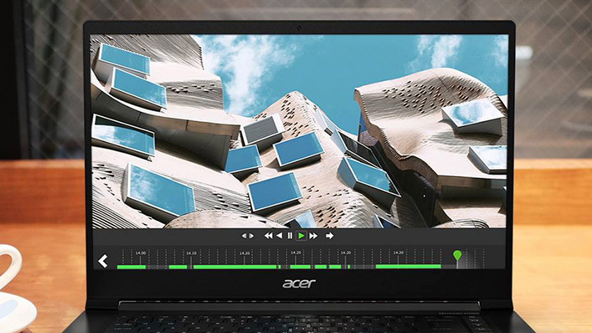 Video editing on an Acer laptop.