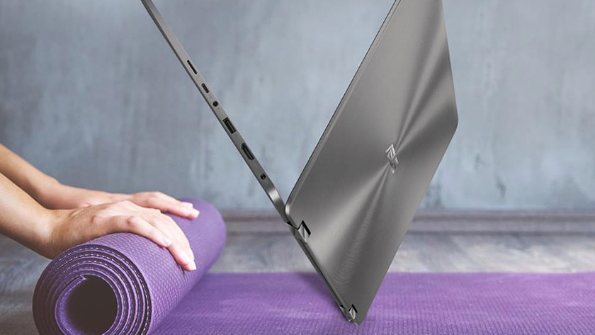 Open Asus ZenBook on a yoga mat.
