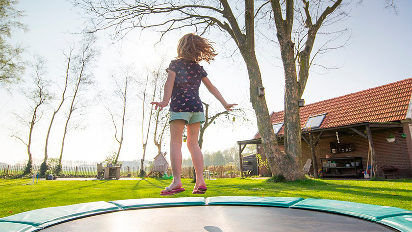 Jumping on the trampoline