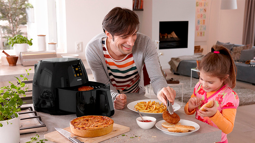 Airfryer with fries, meat, and savory pie