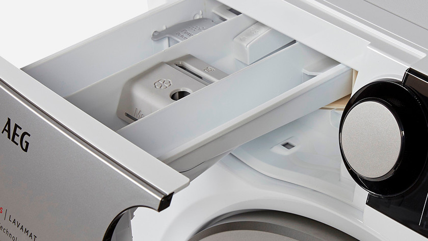 Fill the detergent drawer with descaler
